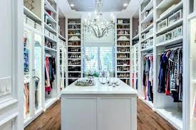 walk in closets with windows closet window seat flanked by shoe shelves transitional gray ceiling