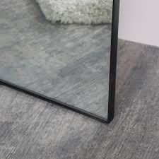 large black thin framed leaner mirror