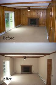 before and after old wall paneling primed and painted may paint all living and dinning room paneling the same