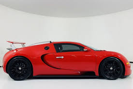 The bugatti veyron is one of the most seminal supercars of the 21st century. Autotrader Find Bright Red High Mileage Bugatti Veyron Autotrader