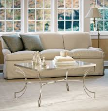 living room design with swing arm floor lamp and glass top wrought iron coffee table