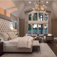 Note how the tray ceiling here helps to complete the luxurious feel of this master  bedroom.