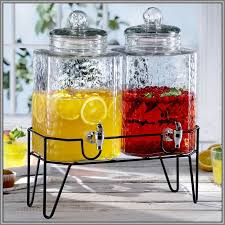 glass beverage dispenser with metal spigot and stand
