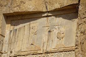 Stone Carvings In Bas-relief On The Tomb Of Xerxes I At Persepolis,.. Stock  Photo, Picture And Royalty Free Image. Image 49527372.