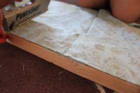 the fabric will fall over the top of the board and down this way the top of the board is covered with fabric and you don t see the exposed board