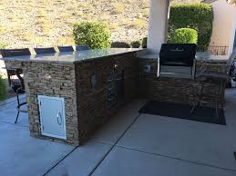 diy bbq island finished in taffy beige stacked stone panels