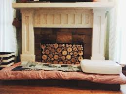 faux stacked log fireplace insert tutorial found here