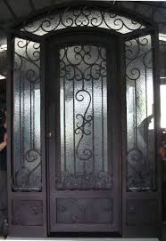single custom frosted glass front doors with black iron for small home design ideas