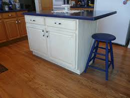 the stools were previously painted burdy i stripped them and painted them a dark cobalt corian countertopsloft