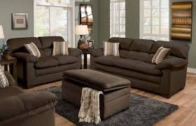 cappuccino sectional sofa set having pillow arms dels also storage ottoman and accent cushion plus grey fur rug on laminated floor