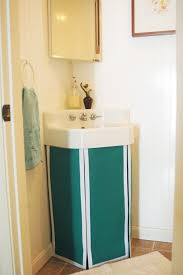 how to cleverly conceal clutter diy fabric curtains skirts covers bathroom sink skirt