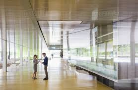 Image Lounge Businessman And Businesswoman Talking In Modern Office Lobby Corridor Dissolve Businessman And Businesswoman Talking In Modern Office Lobby