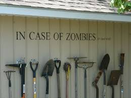 garden tool storage bench. in case of zombies. or yardwork. but mostly very clever garden tool storage display and signage! bench c