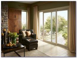 vertical blinds are the obvious choice for patio and sliding glass doors our large selection includes fabric vinyl genuine wood and aluminum finishes