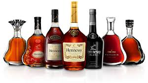 the 9 bottles from the hennessy family sitting on a reflective surface with hennessy vs in