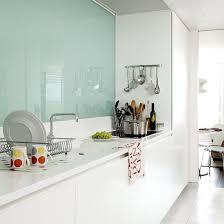 kitchen white glass backsplash. Kitchen With Modern Glass Splash Back In A Galley Kitchen, White Handleless Units And Granite Counter Create Smart, Streamlined Look, While Backsplash
