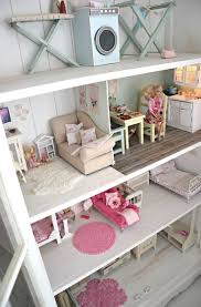 Always wanted a doll house when I was a little girl! Wonderful idea to make  a Doll House out of book shelves! It give you so many options for set up.