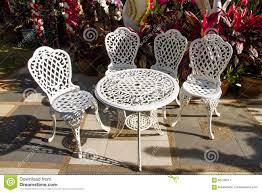 white iron outdoor furniture. Vintage White Iron Garden Table And Chairs In The Garden. Outdoor Furniture