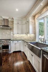 White Cabinets Wood Floor Stainless Appliances Dark Counter Kitchen And Floor Decor
