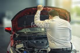 asian man open door car with technology engine on blurry background for