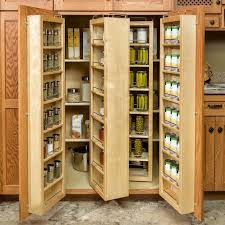 white steel pantry shelf with rectangle wooden door and black wall of pantry cabinets