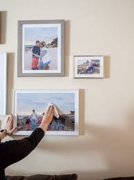 create a wall collage of picture frames use a microfiber cloth to keep your picture frames clean