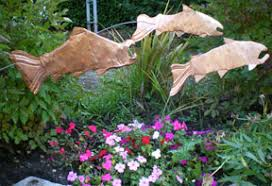 copper garden art. These Playful Copper Salmon Are Mounted On Arching Poles Allowing Them To Gently Move With The Garden Art