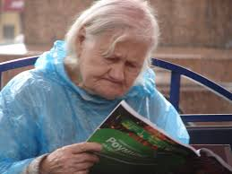 old woman reading by quinn anya