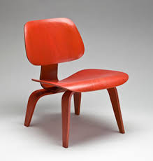 eames plywood lounge chair red. the lcw (low chair wood), also referred to as \ eames plywood lounge red