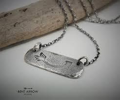 sterling silver arrow pendant bent