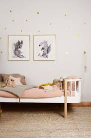 Modern girl's room in blush pink, white, birch and with gold accents.