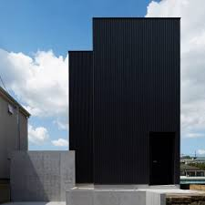 Black corrugated metal encases loft-inspired Tokyo house by TakaTina