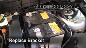 battery replacement 2010 2013 mazda 3 2010 mazda 3 i 2 0l 4 cyl replace the bracket to secure the new battery