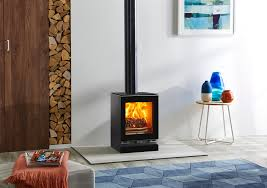 vision small wood burning with optional glass top plate plinth and gloss black flue pipe