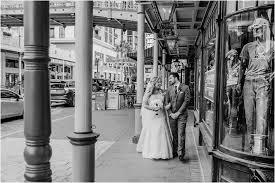 bride groom stroll arm in arm down historic church street in downtown orlando