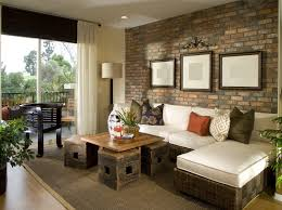 a living room stone wall goes with almost any décor style if you choose the right material in this space the uniform look of brick looks great in this