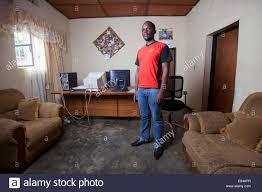 running home office. Rwandan Website Administrator Running An Online Business From His Home Office, Kigali, Rwanda Office R