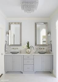 gray dual vanity with alabama marble countertops and backsplash