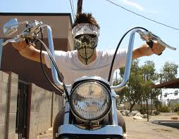 lyle modeling the calavera loca motorcycle riding mask on his harley