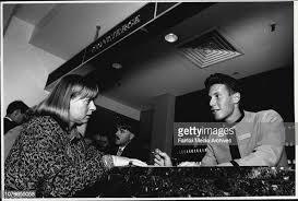 Evelyn Aldridge helps trainee Andre Frack at the Concierge's Desk ...