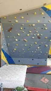 climbing wall with holds rock