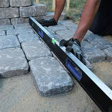 using a straightedge to align paving stones