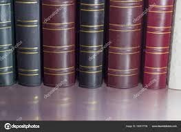 book spines of old leather bound books various colors stock image