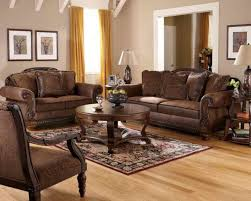impressive tuscan style living room furniture which has twin dark brown leather sofa next to ceiling to floor yellow curtains and twin wall photos which has