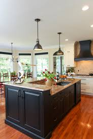 Center Island Kitchen This Large Center Island Features Black Cabinetry And Neutral