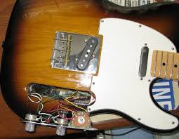 noise reduction for sc pickups telecaster and stratocaster the pickguard is put in place after the neck pu is attached to it the rest of the control cavity wiring is done note the s 1 switch on the volume control