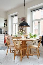a scandinavian interior in total white with a retro mood in pop colours today for i d like to live here find this pin and more on dining room jadalnia
