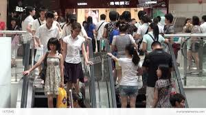 people on escalators. people on escalators in guangzhou shopping mall, c stock video footage