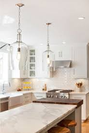 Image Farmhouse Style Modern Farmhouse Kitchen Designthe Light Fixture Above The Island Is The Glass Jug Lantern From Shades Of Light 179 Each Lamps Plus Modern Farmhouse Kitchen Designthe Light Fixture Above The Island Is