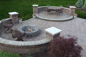 garden and patio backyard house design with outdoor dining area with round dining table and